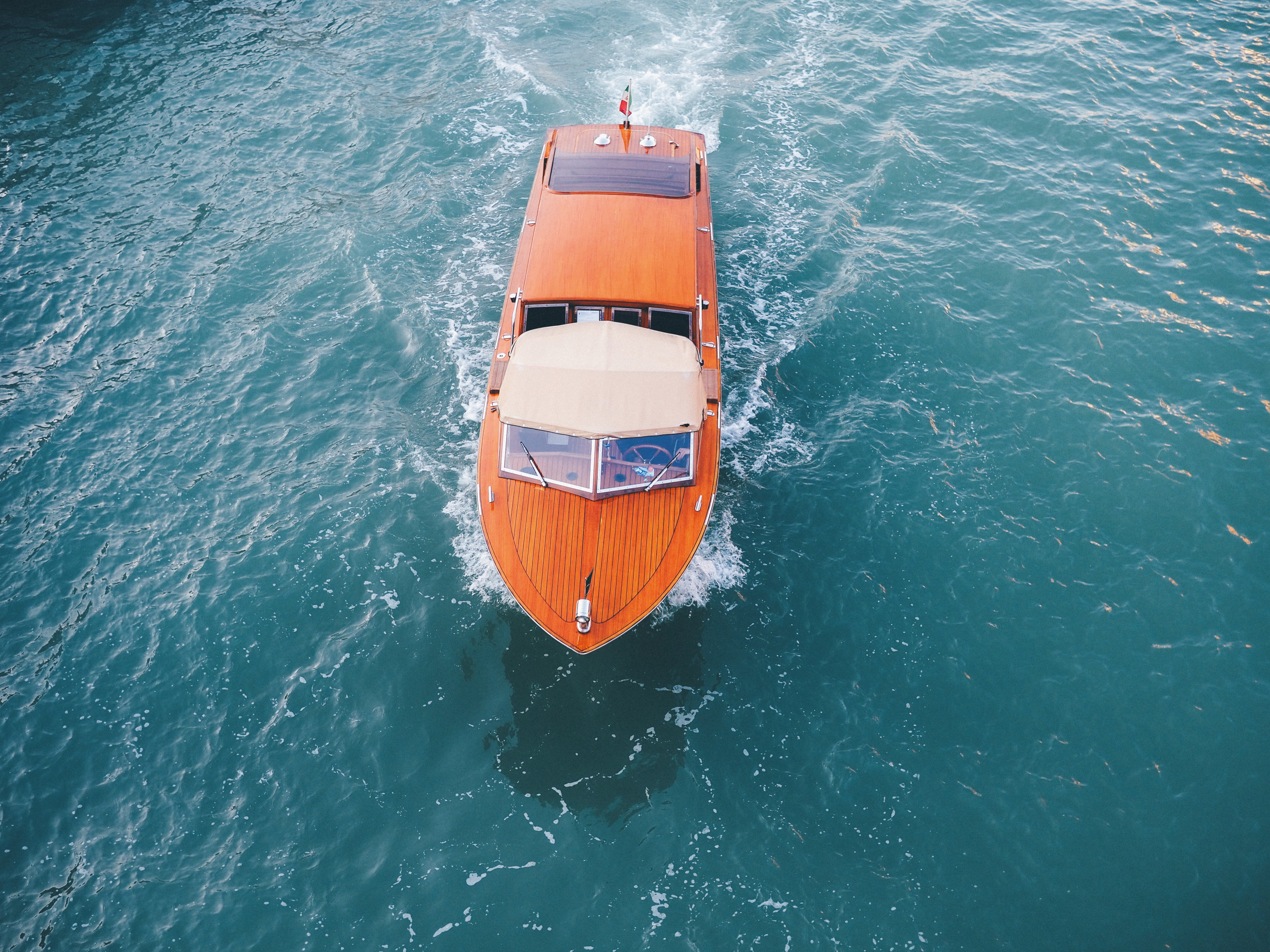 brown-yacht-on-body-of-water-3518400